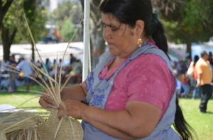 Zapoteca women Juana E. Ramirez Santiago weaving a petate at Los Angeles' Guelaguetza 2012
